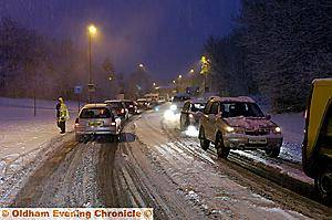 WHITE HELL: THIS was the scene in Lees Road, Oldham, this morning as heavy overnight snow and sub-zero temperatures brought chaos to the borough. Commuters faced an icy crawl to work and schools were forced to close for the day. Delph was cut off and other drivers were forced to abandon their vehicles.
