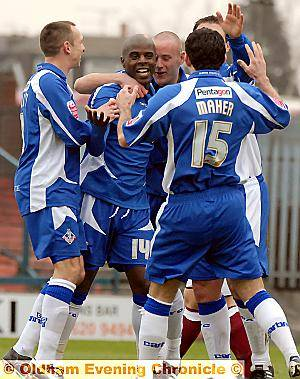 EVERYBODY HAPPY: Reuben Hazell is mobbed by his delighted team-mates after his eighth-minute header had given his side the lead.