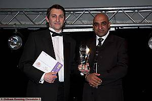 BUSINESSMAN: Rod Boyes (left) collects Martin Littler's award from Mohammed Rahim, chairman of the Asian Business Association.