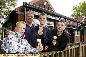 ICE CELEBRATIONS . . . Cafe owner Mike Cumiskey treated youngsters (from left) Sam Motley (10), Andrew Urmson (14) and Jack Motley (14).