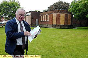 GET IT LISTED . . . Michael Lawson , from Chadderton Historical Society, outside Broadway Library which is in danger of being demolished.