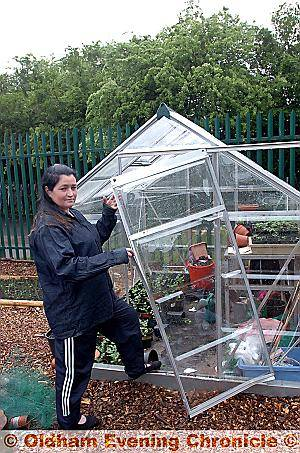Project chairman Stephanie Wilde and the vandalised greenhouse at Alt Primary School's community garden
