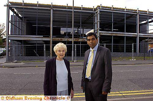 Royton North councillor Olwen Chadderton and councillor Mohib Uddin, cabinet member for Regeneration, outside the frame of Royton Assembly Hall.