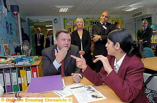 "COMMUNICATION . . . Ed Balls learns the sign language for ""thank-you"" with pupil Nafisa Rehman, watched by head Carol Cawkwell and governor Basit Shah. Picture by VINCENT BROWN"