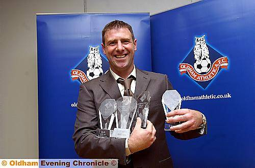HANDFUL: Sean Gregan, Athletic's outstanding player of the 2009/10 season, shows off his four awards.