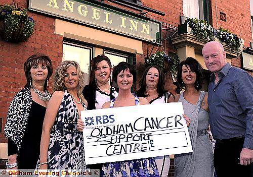 CHARITY cheer . . . presenting the cheque to Chris Hoyle of Oldham Cancer Support Centre are, from left, Beverley Heap, Sara Wrigley, Fiona Southall, Diane Bridgewater, Rachael McGhee and Andrea Derbyshire
