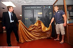 MEMBERS OF THE BOARD: Jamie Edwards (left) and Kevin Sinfield perform the unveiling ceremony at Oldham Sports Centre.
