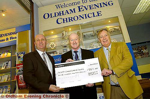 CHARITY bowled over: Chronicle Editor David Whaley (left) with Chris Hoyle and John Lord, the competition president.