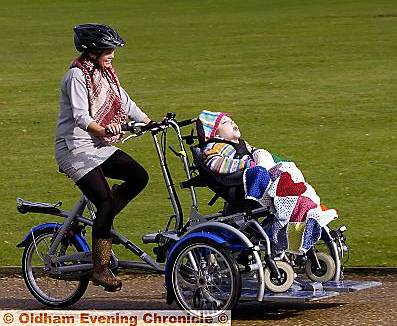 Fun for all . . . Chantel Slicker and Sophie Robinson on a specially-adapted bike