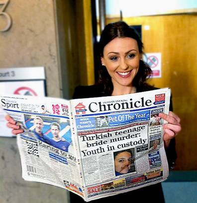 WELL read . . . Suranne (right) holds up a specially-produced copy of the Oldham Evening Chronicle.