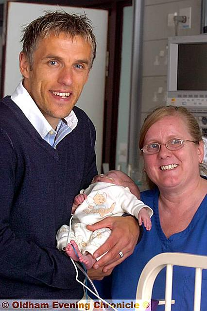 HEALTHY START: Phil Neville with staff nurse Susan Davey and three-month-old Harry Wilkinson.