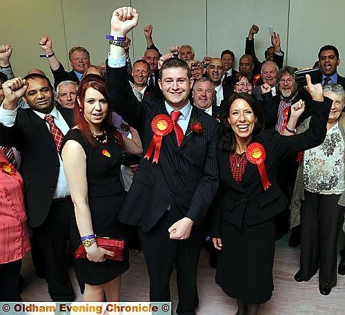 VICTORY! Jim McMahon celebrates with his partner Charlene Duerden, left, and Debbie Abrahams, MP for Oldham East and Saddleworth