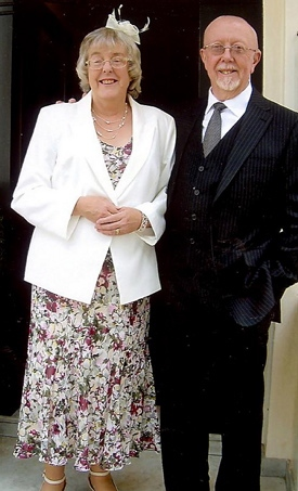 ROYAL appointment . . . Barry and Sue Haslam ready to take tea with the Queen
