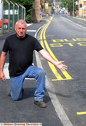 End of the line: David Marsh says his protest means the double yellow lines don't reach the end of the road