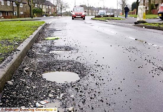 Potholes awaiting repair litter Oldham's roads.