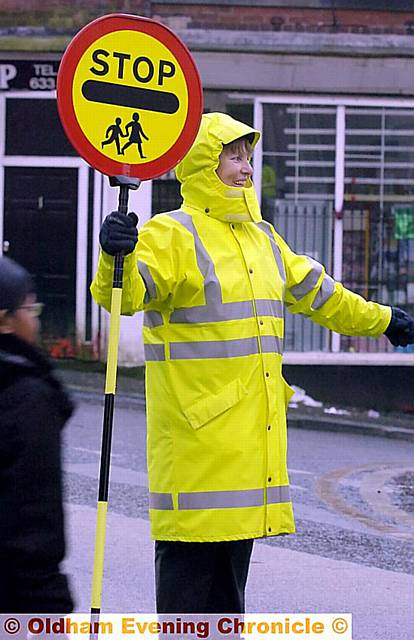 Irene Bennett, one of Oldham's popular lollipop crossing patrols