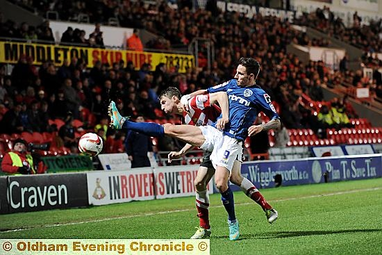 GET BACK: Athletic forward Matt Derbyshire attempts to nick the ball away from his Doncaster Rovers rival.