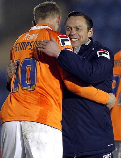 Athletic boss Paul Dickov embraces Robbie Simpson after victory against Colchester.