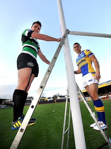 Kevin Sinfield (right) and Leeds Carnegie's Joe Ford with the new posts on the relaid Headingley pitch