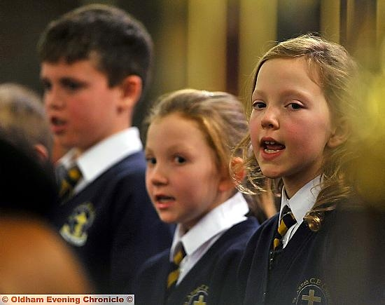 IN tune: Ella Dibden (right) with St Anne's CE School choir, Lydgate
