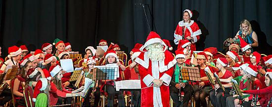 SANTA took time out from his busy schedule to conduct the wind band