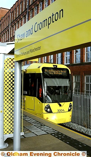 THE TRAM NOW ARRIVING: the first tram stops at the new Shaw and Crompton station.
