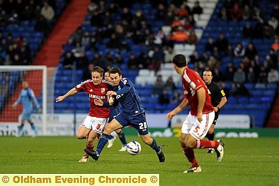 NO YOU DON�T . . . Jose Baxter finds his way to goal blocked by disciplined defending.