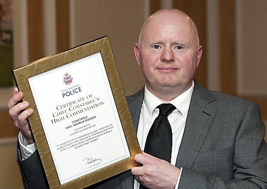LIFESAVER . . . brave PC Carl Bugden shows off his special commendation award