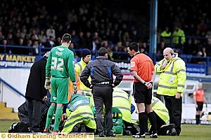 CONCERN . . . paramedics attend to Youssouf Mchangama at Gigg Lane on Saturday.