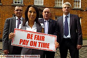 MP Debbie Abrahams challenges FTSE100 companies to sign the Prompt Payment Code. Pictured with her from, the left, are Philip King, Phil Thompson (Federation of Small Businesses and Phil McCabe (senior policy advisor with the Forum of Private Business)