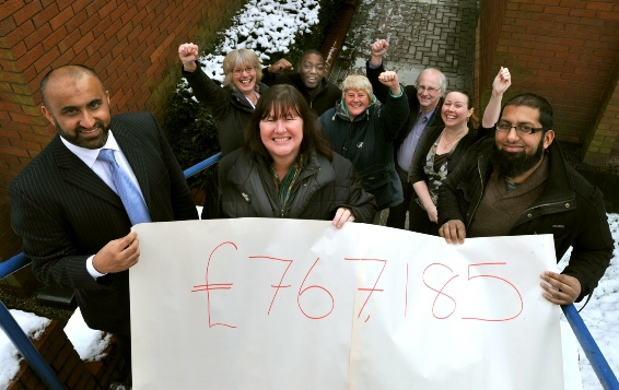 Celebrating Oldham�s �767,185 Lottery windfall are (front, from the left) Tariq Rafique Oldham Race Equality Partnership director, Bev Taylor, from the Key to the Door project, and Aminul Hoque, Vision Youth and Community project manager, with some of the workers who will make sure the money benefits local people