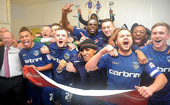 DREAMS can come true: Oldham Athletic players and staff celebrate yesterday�s stunning FA Cup victory over Premier League giants Liverpool