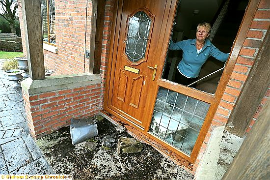 ORDEAL: Kay Warburton inside her house which was targeted by burglars