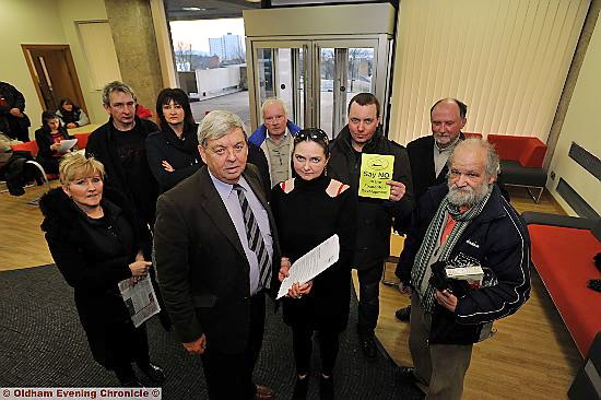 Foxdenton and District Protection Group chairman Christine Gater hands the petition to Councillor John Battye at Oldham Civic Centre.