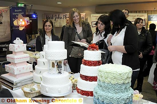 Choosing a cake from Little Kiss Cupcakes durin the bridal fair
