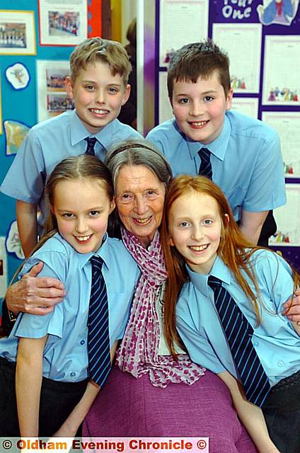 Head teacher Maureen Barnett retires from East Crompton St. James's School at the age of 80. Pic with some of her year 6 pupils, clockwise from back left, Matthew Taylor, Ben Pellowe-Hill, Milly Sikora, Georgia Taylor. 