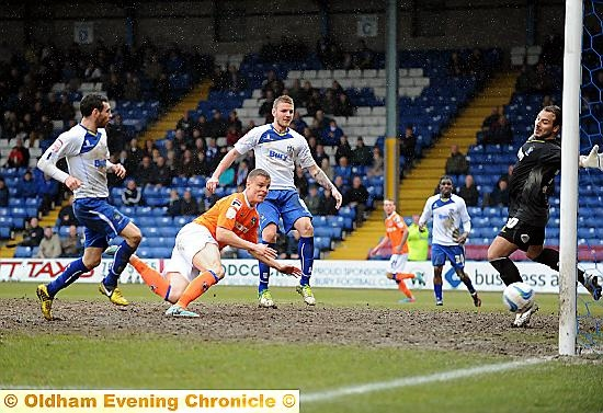 STOOPING TO CONQUER . . . Smith relegates Bury at Gigg Lane
