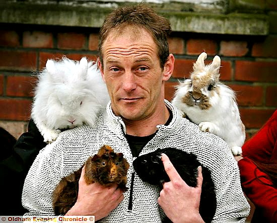 FLUFFY Foursome . . . Mark Hilton with the rescued rabbits and guinea pigs.
