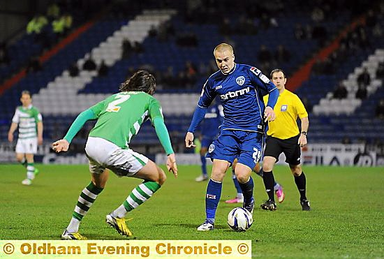 CONTRACT: Athletic midfielder David Mellor, in action against Yeovil last month, is staying at Boundary Park.