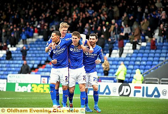 BROTHERS IN ARMS . . . Athletic scorer Danny Philliskirk (second right) is mobbed by Connor Brown, Jon Stead and David Worrall.