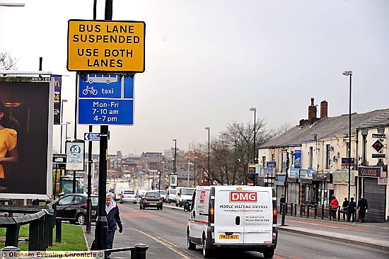 conflicting blue and yellow signs on Huddersfield Road