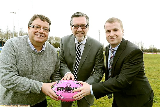ON the ball: Oldham Rugby chairman Chris Hamilton (left) with Oldham College principal Alun Francis andcollege head of sport John Pietrzak
