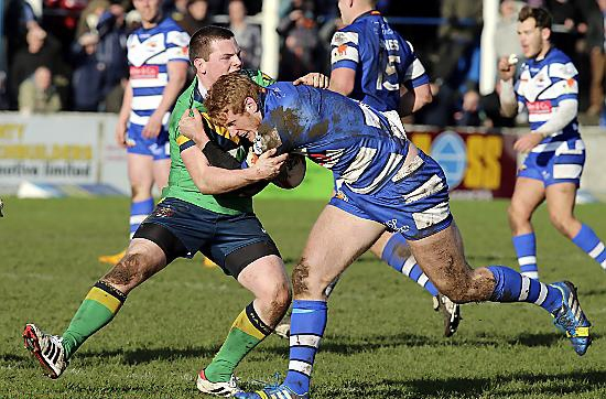 Oldham�s Adam Files gets to grips with a Barrow Raiders opponent.
