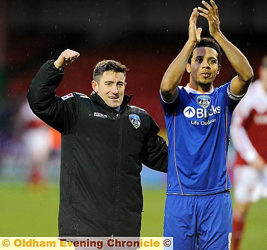 BOSS Lee Johnson and skipper Korey Smith celebrate in front of the Athletic fans after Saturday�s win at Swindon. Smith was the subject of two bids on transfer deadline day.