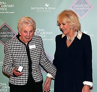 DIAMOND Champion . . . Doreen Smith receives her pin from the duchess