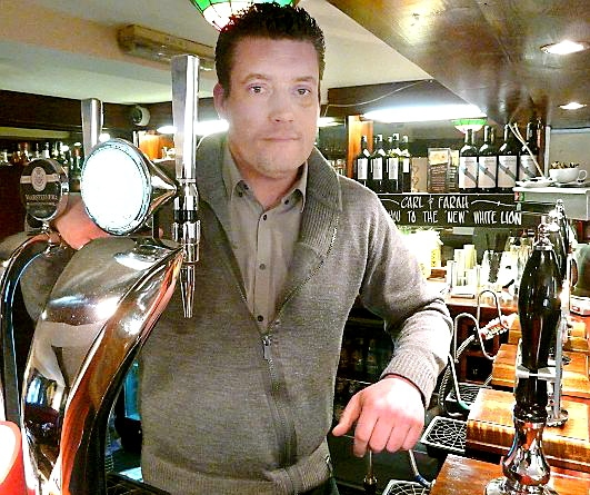 ANGER . . . White Lion landlord Carl Benton was assaulted in his own pub