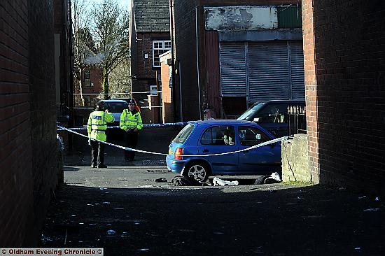 Police at Brompton Street, Glodwick - sealed off after man found collapsed