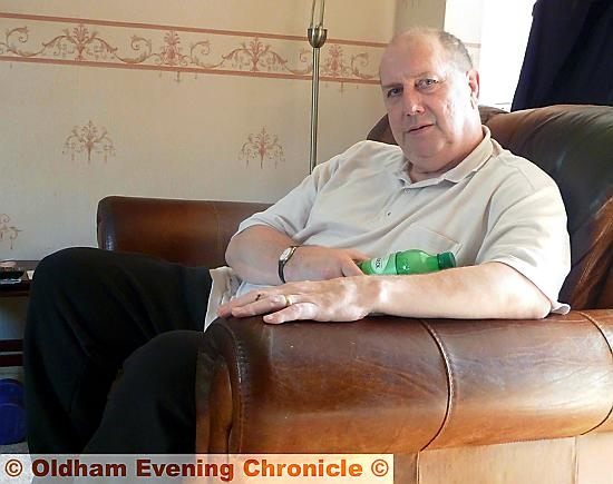 TREATMENT ... Councillor Adrian Alexander relaxing at home.