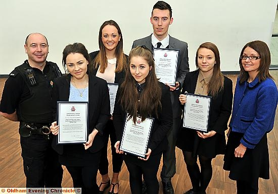 TOP class . . . (from left) PC Ian McDonald, Meg Glendinning, Natalie Hulme, Nicole Hankes, Louis Gilligan and assistant head teacher Adelle Greenwood