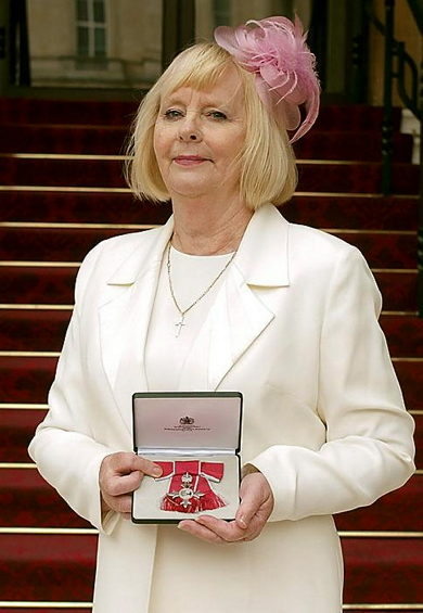 HONOUR . . . Angela receives her MBE at Buckingham Palace